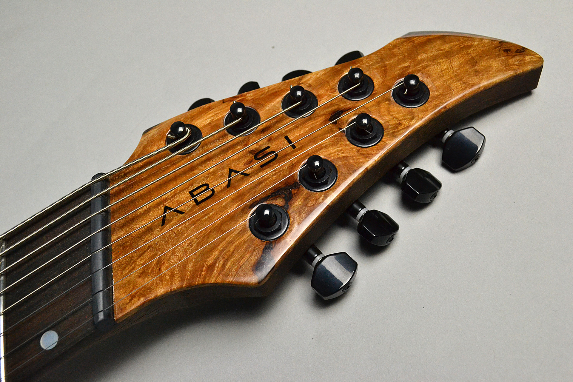 Abasi Guitars 8st Multi Scale(Fanned Fret) Burl/Ebony Natural Stainのヘッド画像